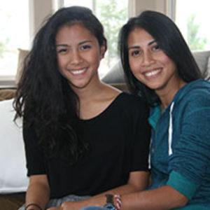 two nonwhite teenage girls smiling