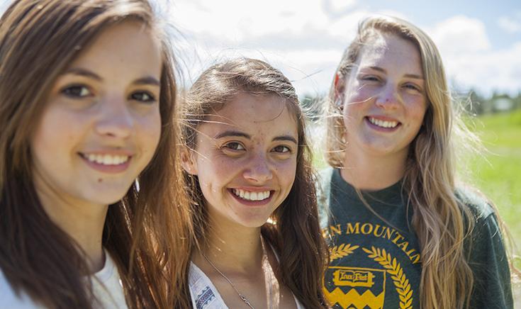 three teenage girls looking at camera